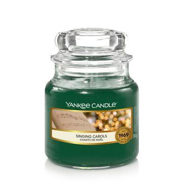 Yankee Candle – Świeca zapachowa mały słój Singing Carols (104 g)